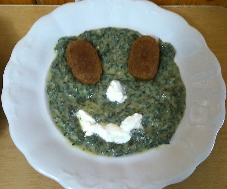 Smiling nettle food. My recipe.Ingredients:young nettle,salt,sour cream,garlic,flour,water.Fasirt and cream (sour cream)decoration.
