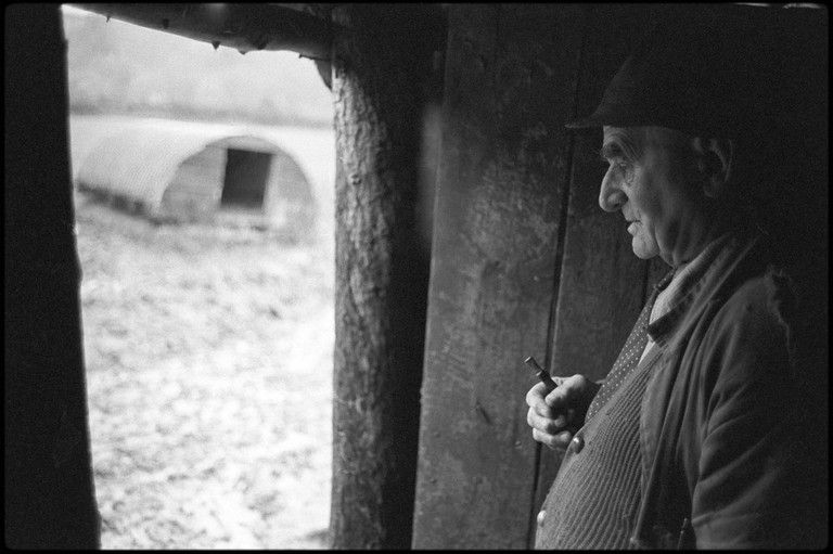 Archie Parkhouse sheltering in a shed by James Ravilious © Beaford Arts