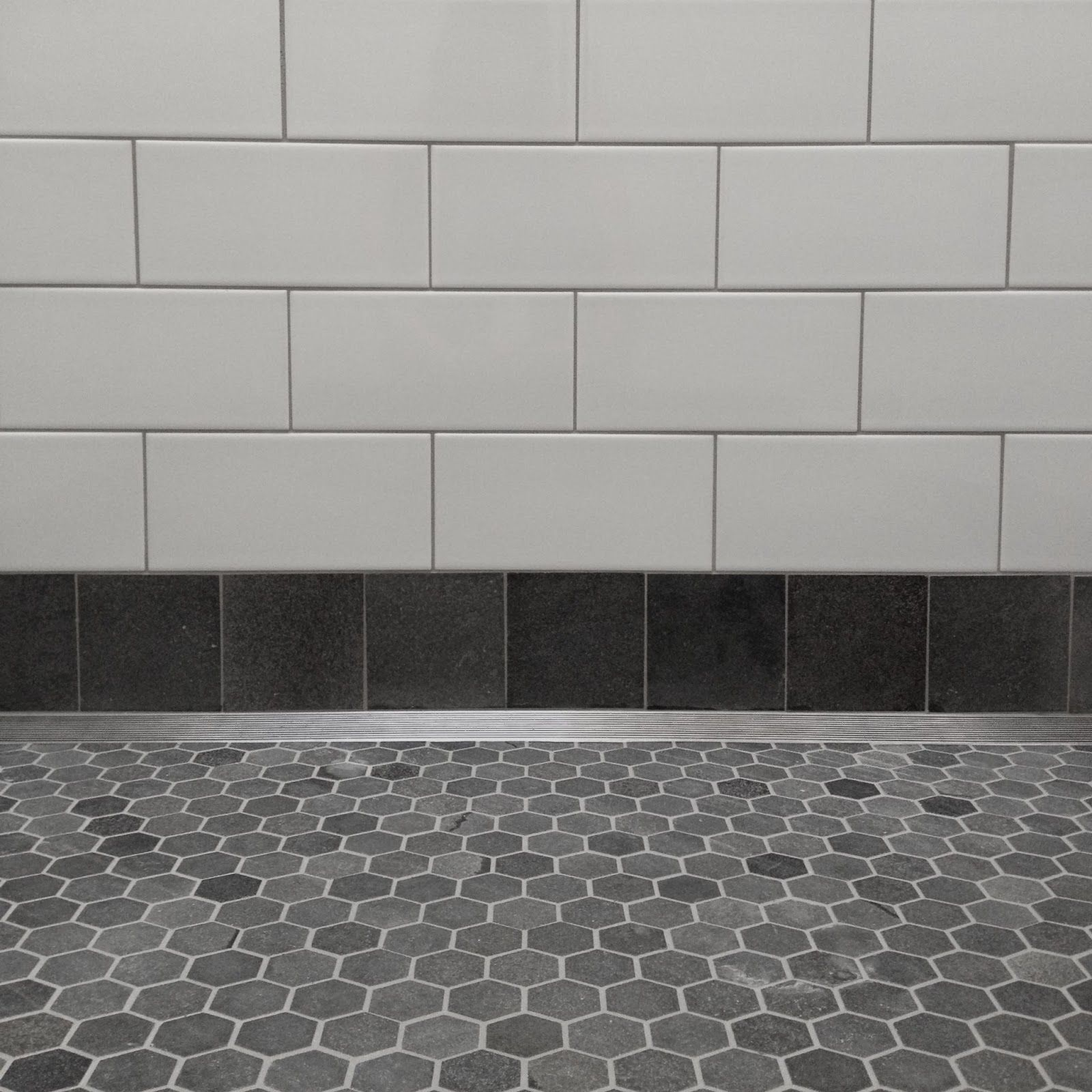 Bluestone Hexagons With Ceramic Subway Tile Surfaces