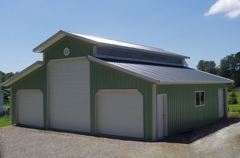 Pole building design monitor roof buildings monitor for Pole barn home plans with garage