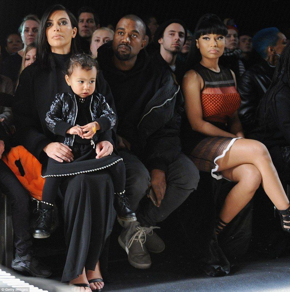 Kim Kardashian And Kanye West Carrying Saint And North Who Is Crying Best Fan Kimye Kim Kardashian And Kanye
