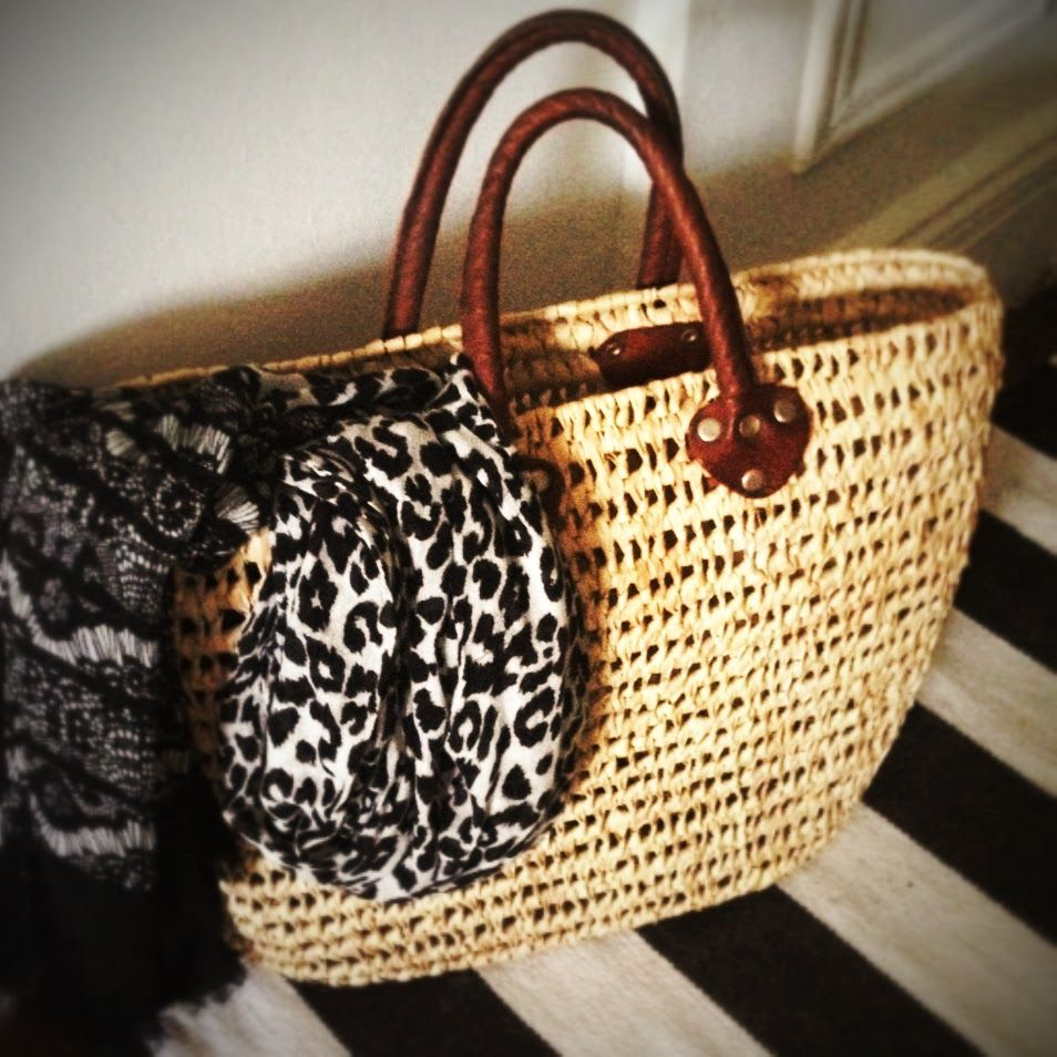 Scarf by Anne Klein; bag handmade in Morocco.