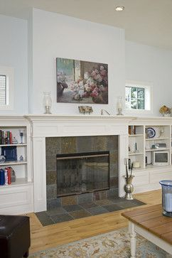 Slate tile around fireplace with white columns and mantle. I like ...