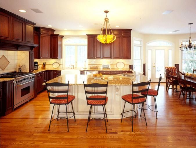 Cherry Cabinetry With Accent Color Island Home Kitchens