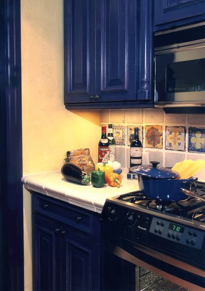 Mediterranean Kitchen With Blue Cabinets Black Appliances White Tile Counter Tops Amazing