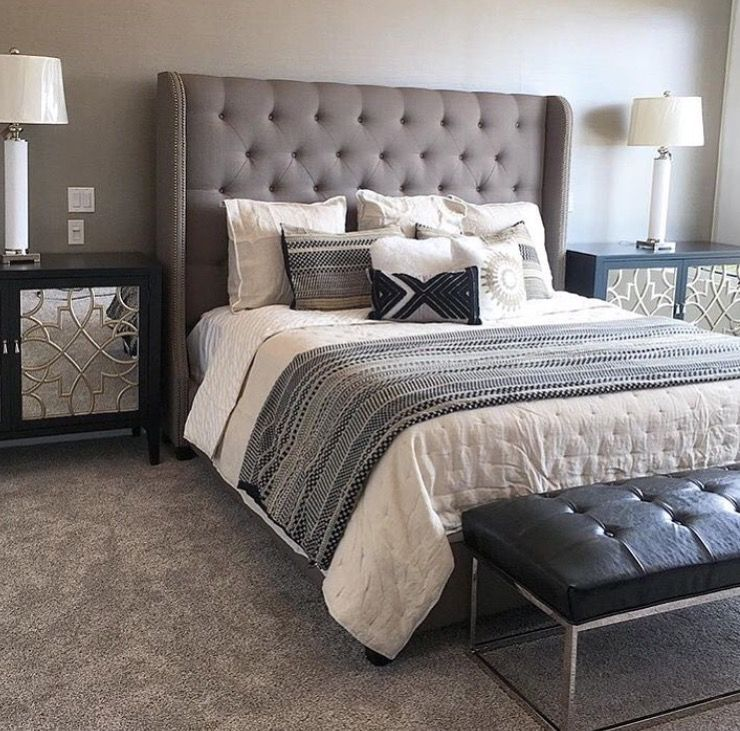 A Grey Tufted Fabric Headboard Pairs Perfectly With Leather