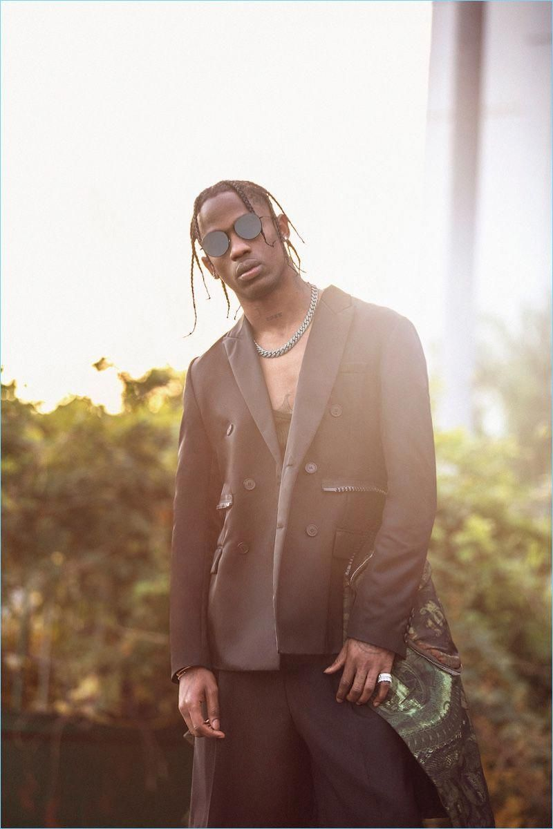 Travis Scott rocks a double-breasted jacket, tank, and shorts by Givenchy with RetroSuperFuture sunglasses. #travisscottwallpapers Travis Scott rocks a double-breasted jacket, tank, and shorts by Givenchy with RetroSuperFuture sunglasses. #travisscottwallpapers