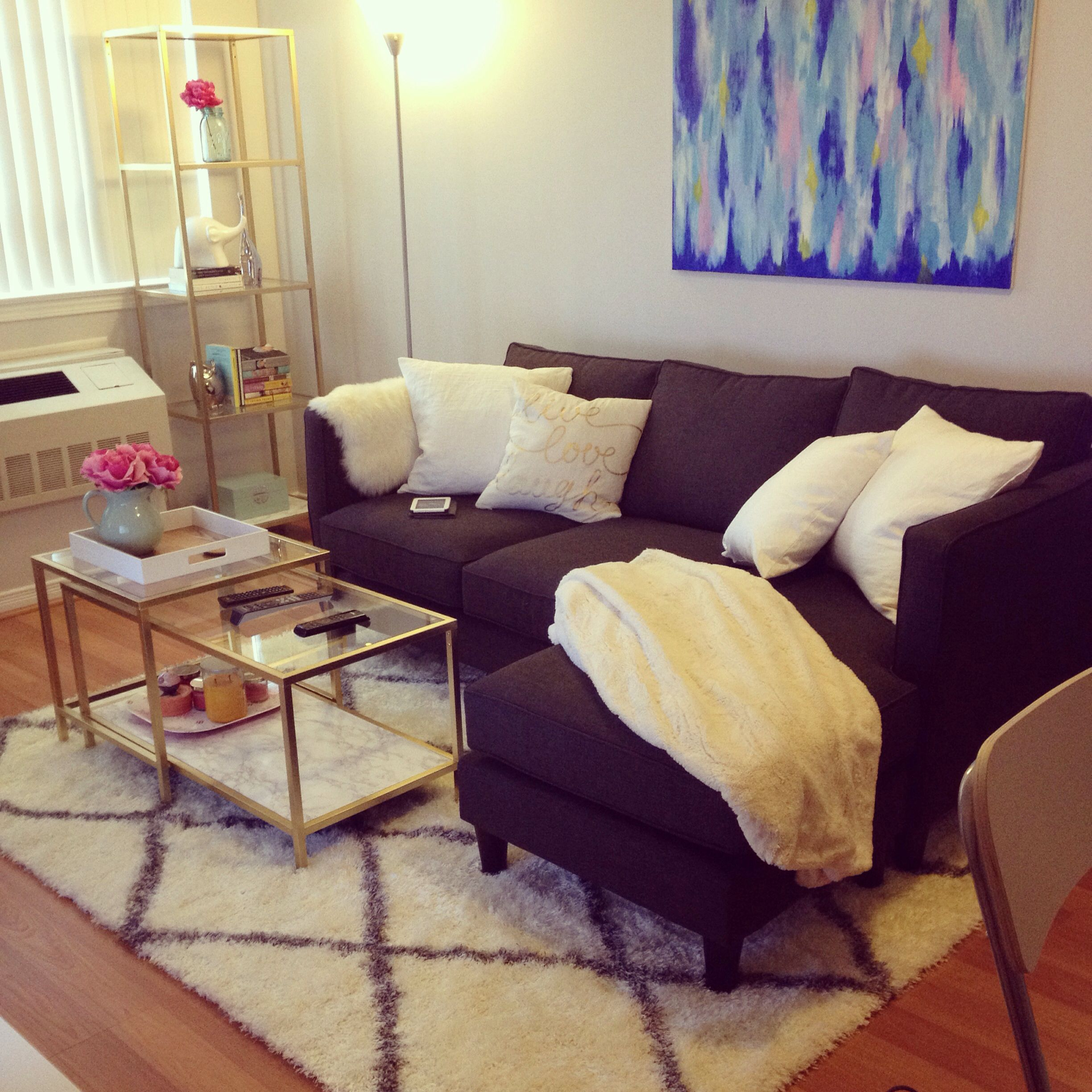 ikea hack vittsjo coffee table and shelf couch from urban barn shag rug from rugsusa and diy abstract painting decorating on a budget