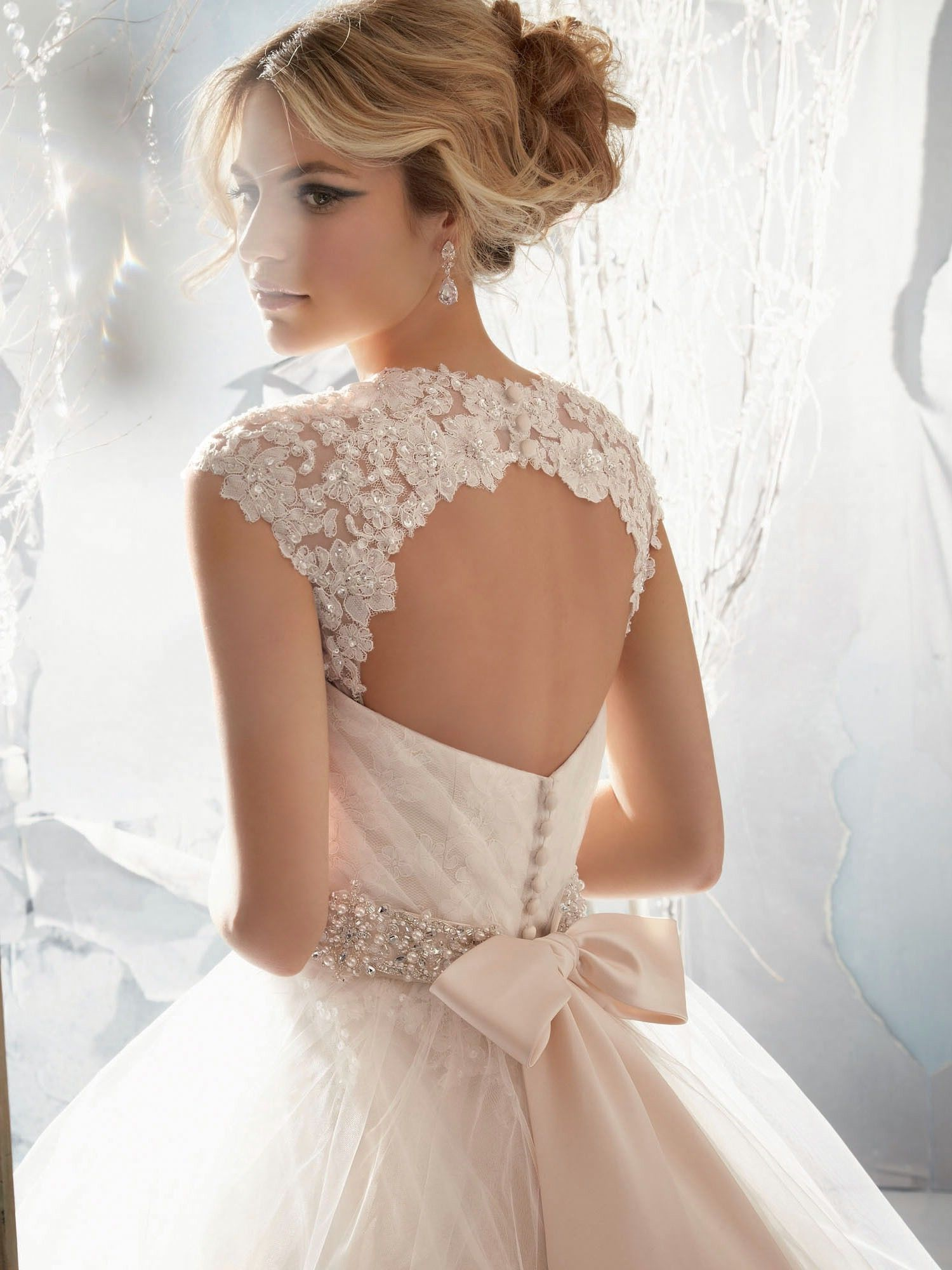 Found on weddingbee adding straps match with front picture for