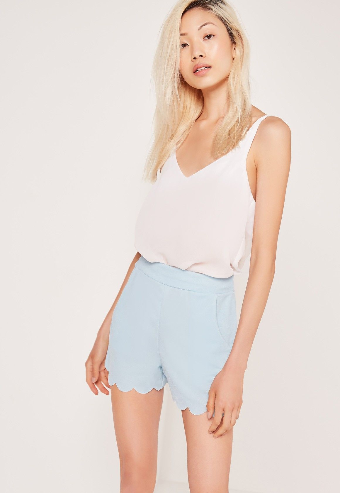 Holy crepe! These shorts are perfect for summer strollin' and night time antics, featuring a light blue hue, scallop edging and a light crepe material, you'll be rocking these day through 'til play. Style with a chic bralet, heeled sandals ...