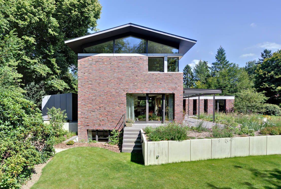 Einfamilienhaus mit schwebendem dach und veranda in bremen moderne häuser von möhring architekten