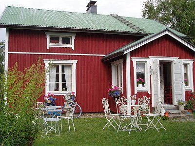 traditional finnish wood house painted red. /bed & breakfast