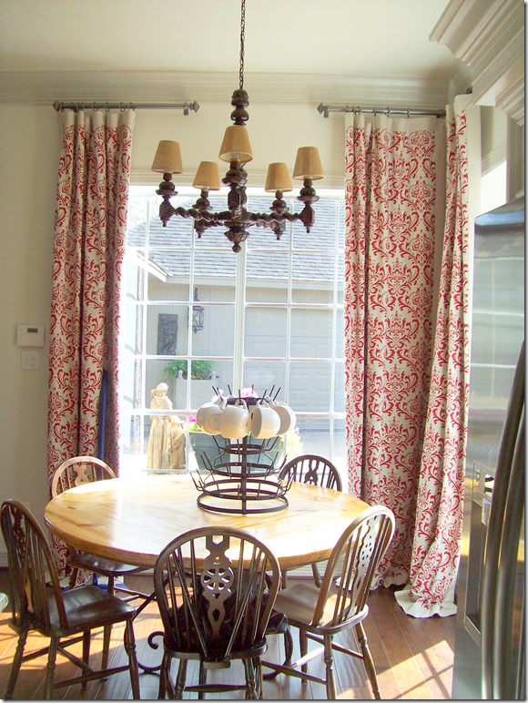 Love the curtains mounted high above windows...sliding glass door?