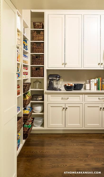 Lovely Walk In Pantry Features Ivory Cabinets Topped With Quartz