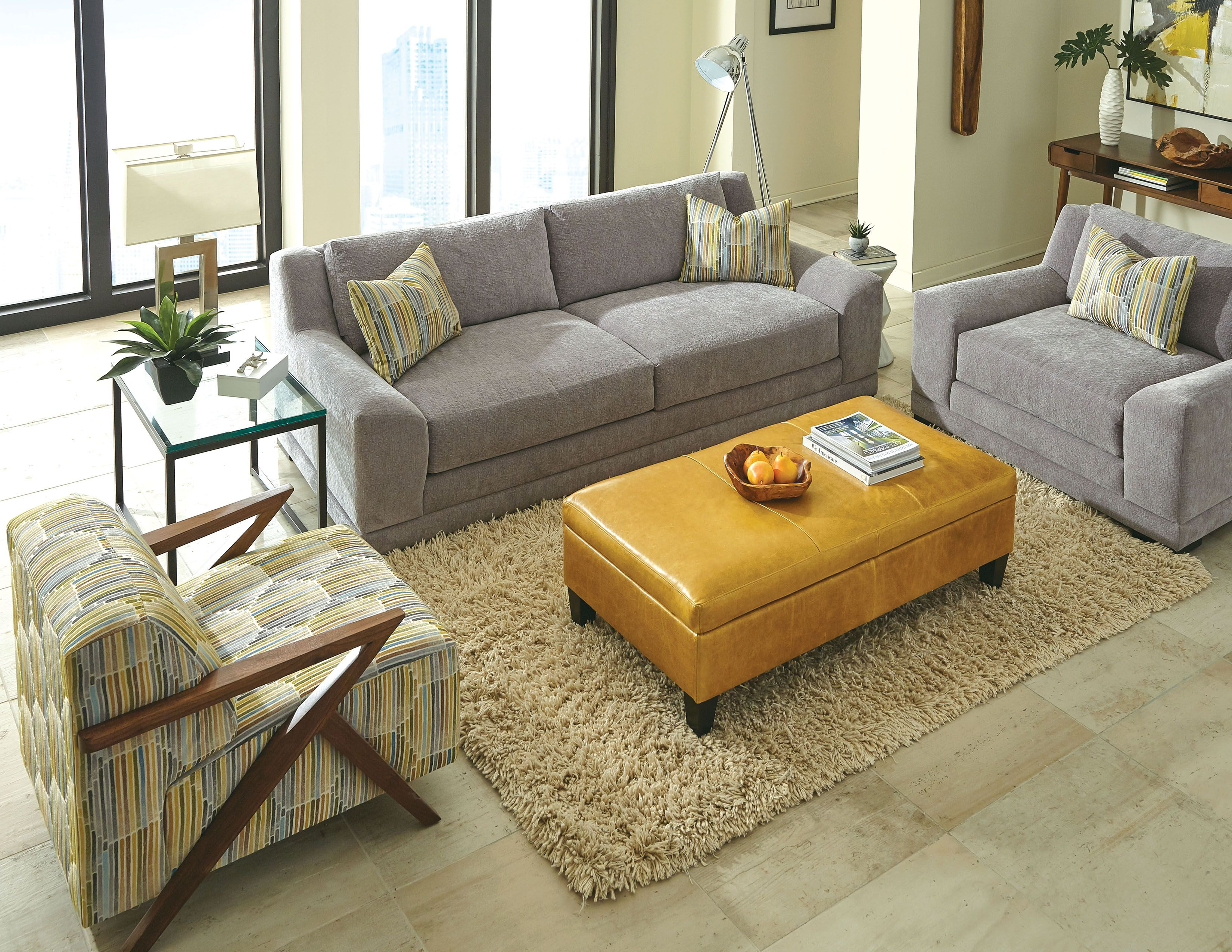Pair grey tones with bright pops of color like mustard to create a