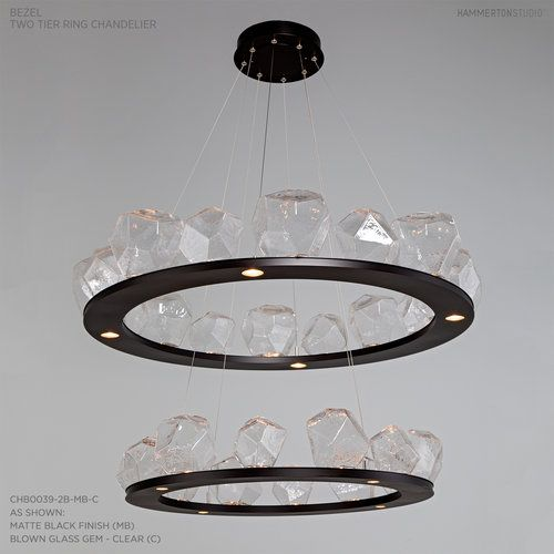 This contemporary modern lighting design features led down lights shown here in clear glass and matte black finish