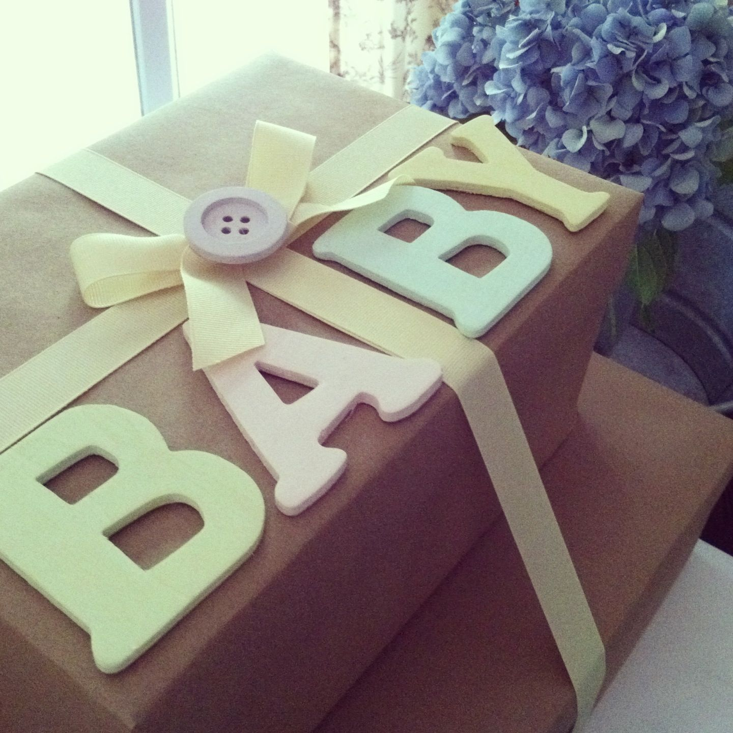 Baby shower gift wrapping brownpaper wrapping baby