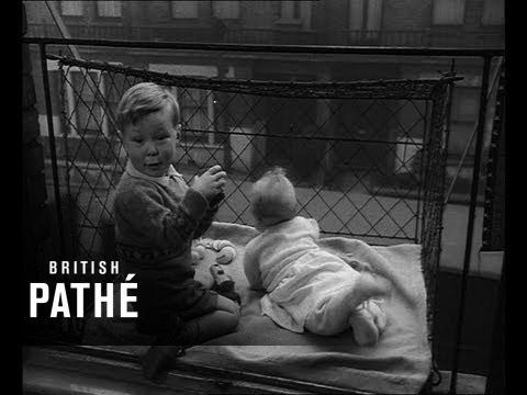 Vintage Everyday Incredible Pictures Of Baby Cages Hanging Outside London Apartment Windows 1930s