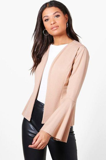 9f1a3c75687 Isabella Flare Sleeve Collarless Blazer by Boohoo. Wrap up in the latest  coats and jackets