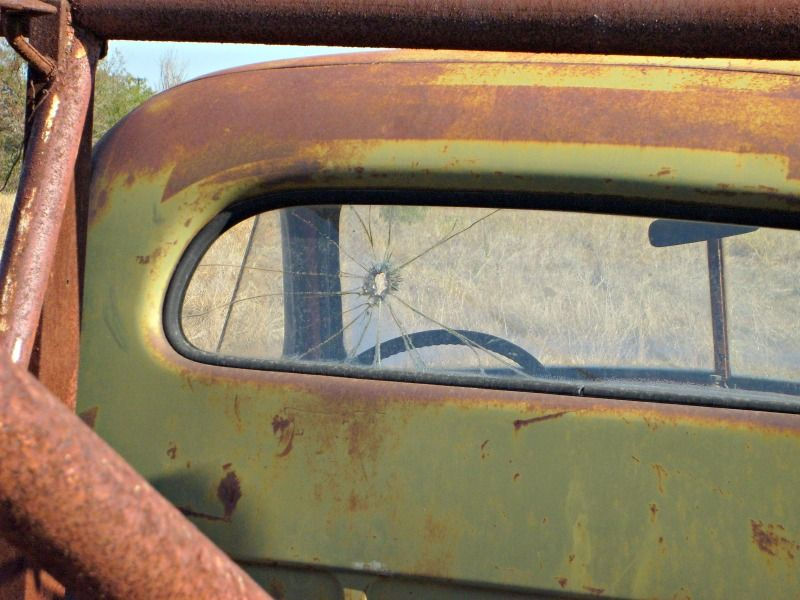 Looking at the cab from behind the abandoned Studebaker tow truck.