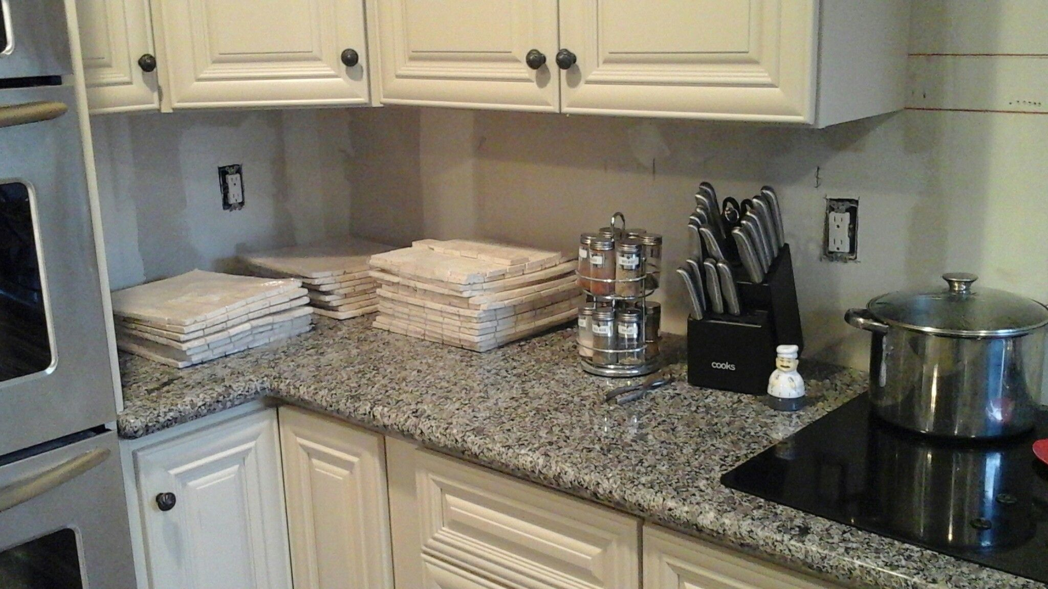 Best Ivory Cabinets Against Grey And Silver Speckled Granite 400 x 300
