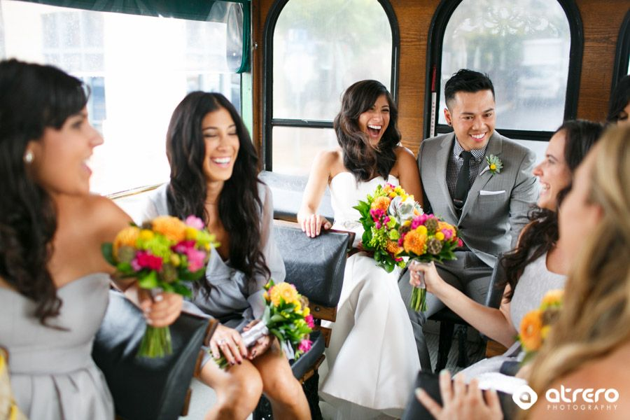 A fun trolley ride to the wedding ceremony in Downtown San Diego by Atrero Photography. See more photos at www.atrero.com