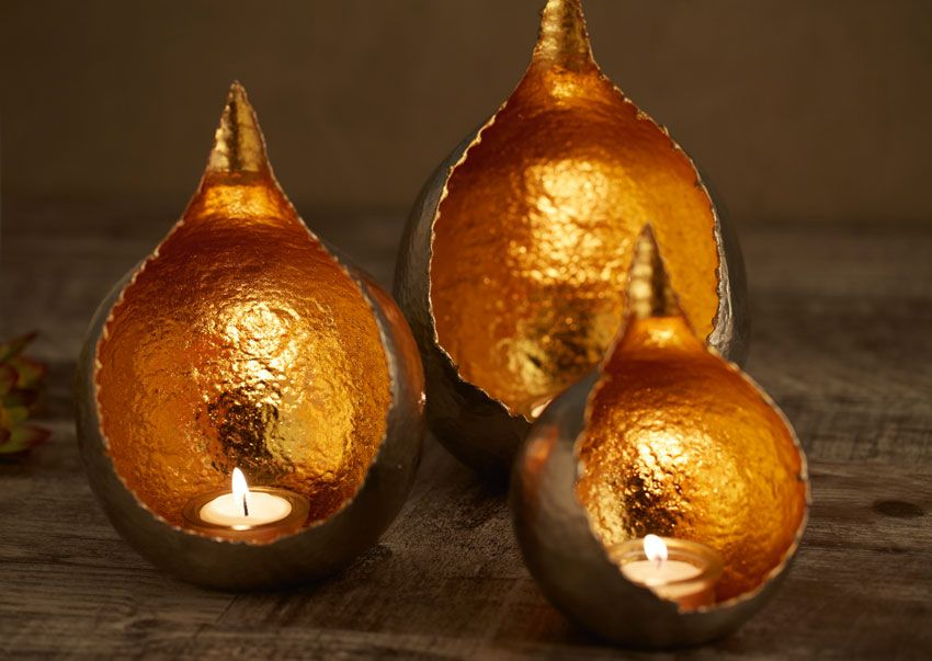 The latest addition to the divine Koh Metálico range of handmade metal candle holders have a tear drop shape and pure gold leaf to cocoon a stunning soft glow when lit.