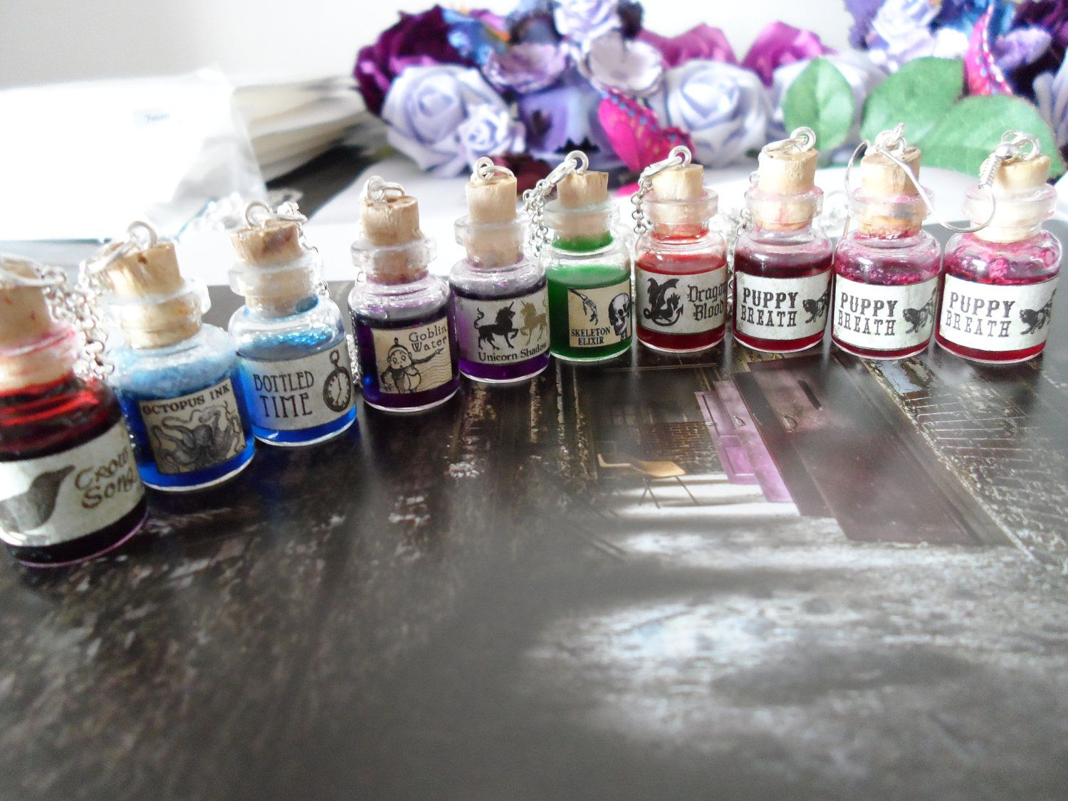 Potion bottle necklaces, 7 colours and 23 labels to choose from. £6.00, via Etsy.