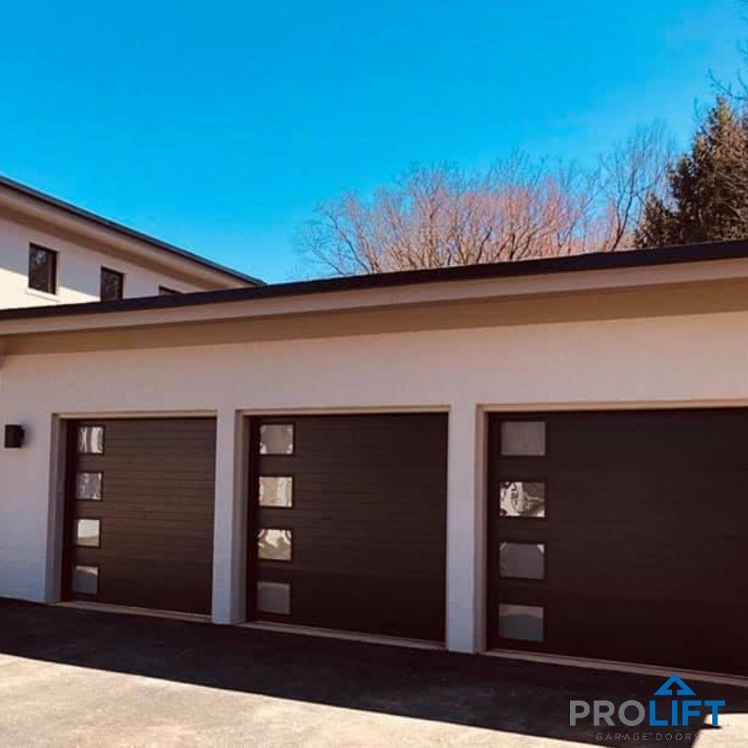 Clopay Modern Steel Garage Doors In Chocolate In 2020 Garage Doors Modern Garage Doors Garage Door Design