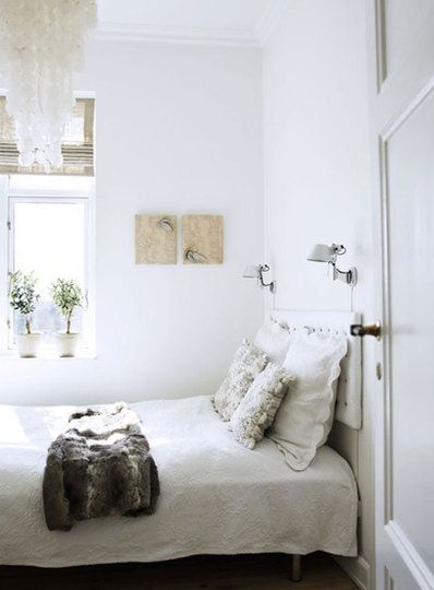 white and light bedroom with natural textures