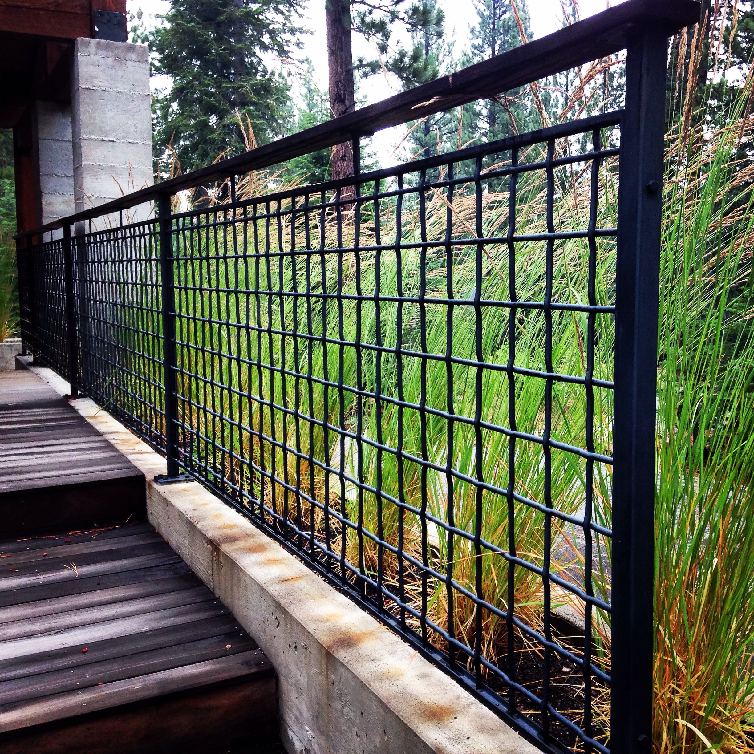 Martis Camp Home With 4 Mesh X 3 8 Ga Woven Wire With A 1 2 X1 X1 8 C Channel Frame With A Black Texture Powder Coat Railings Outdoor Wire Mesh Fence Fence