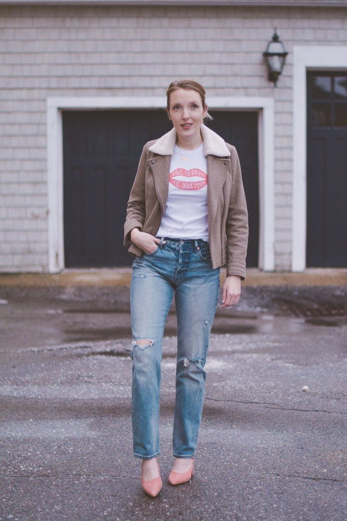 Leslie Musser wearing high rise straight jeans with a shearling collar jacket, graphic tee, and pink block heel mules // one brass fox