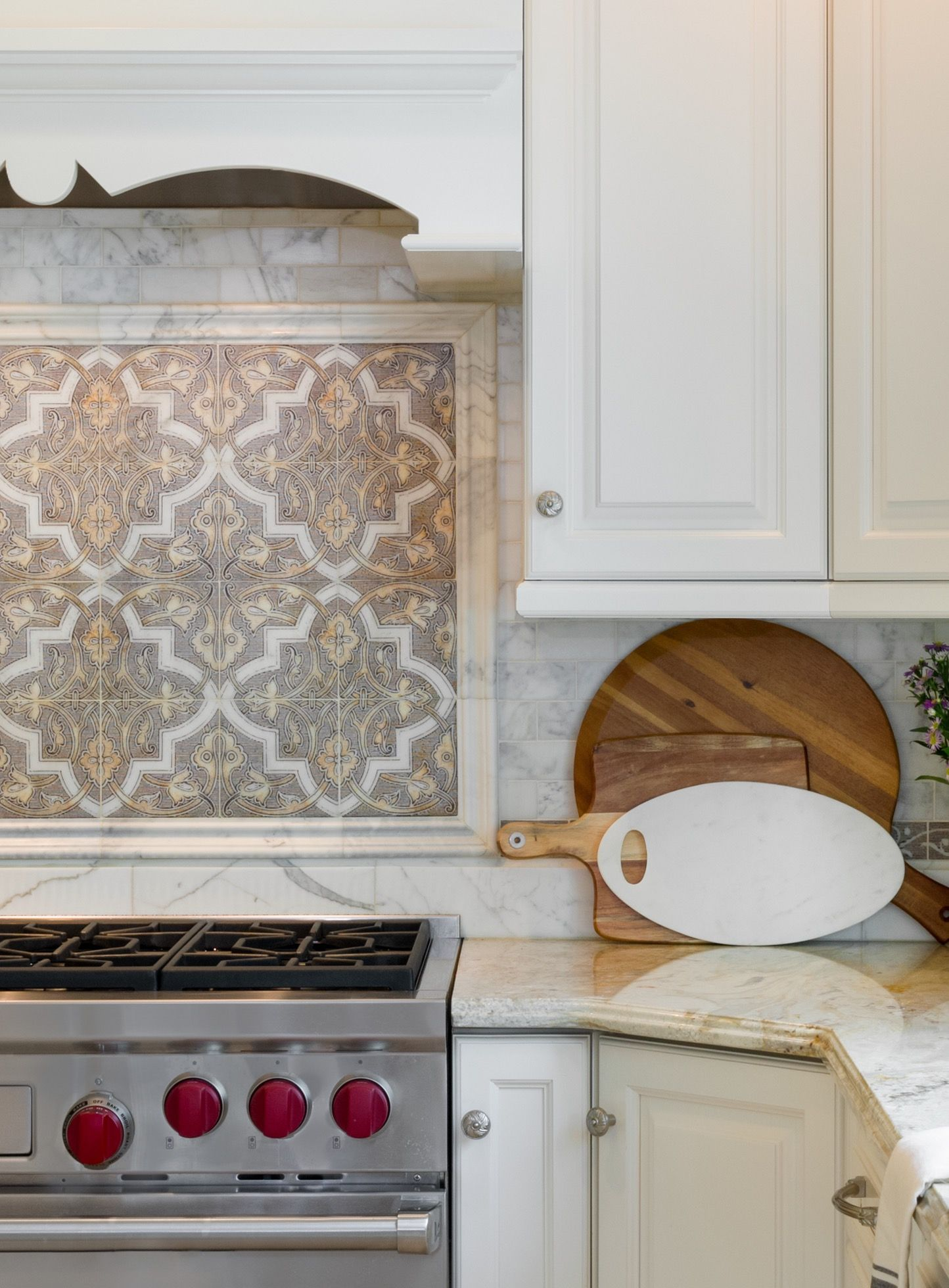 Close up look at this elegant kitchen backsplash on carrara marble ...