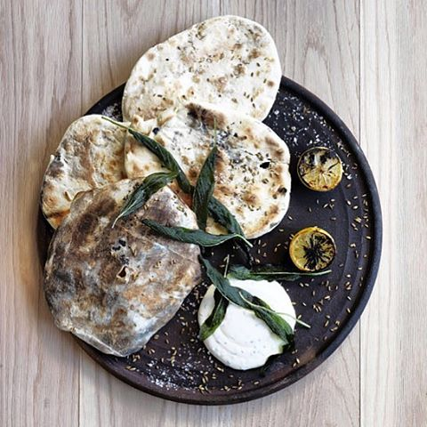 Recipes created for @mrsrobertplumb BOLLYHOOD OVEN by James Viles @biotadining. FIREWALL bread with goats milk cheese and sage.