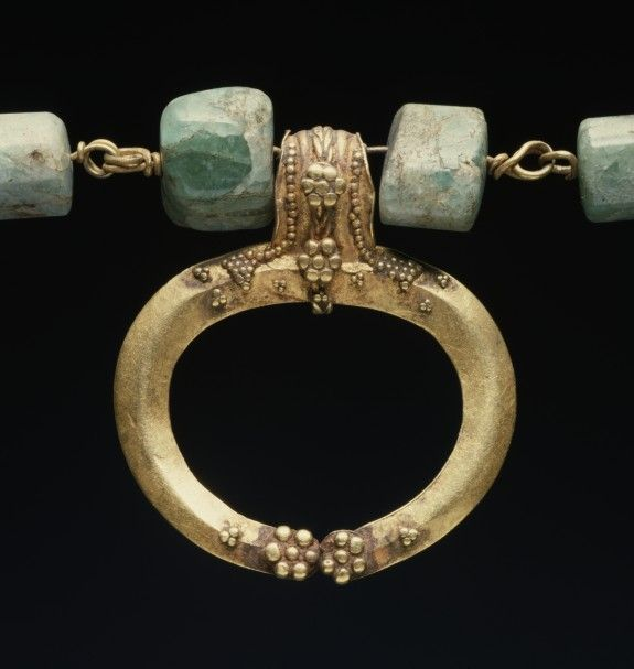 "Closeup of 1st AD Roman gold filagree lunula pendant on gold and agate necklace. Held at Walters (Acc 57.525).  1 3/8"" w x 3/8"" d x 14"" l (3.5 x 0.9 x 35.5 cm); as photographed at clasp: 3 15/16"" w x 7 7/8"" l (10 x 20 cm)"