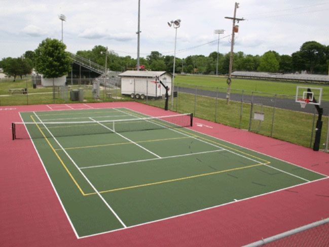 A Tennis Court Put To Good Use On School Property With Side Basketball Courts Outdoor Basketball Court Tennis Court Tennis Court Backyard