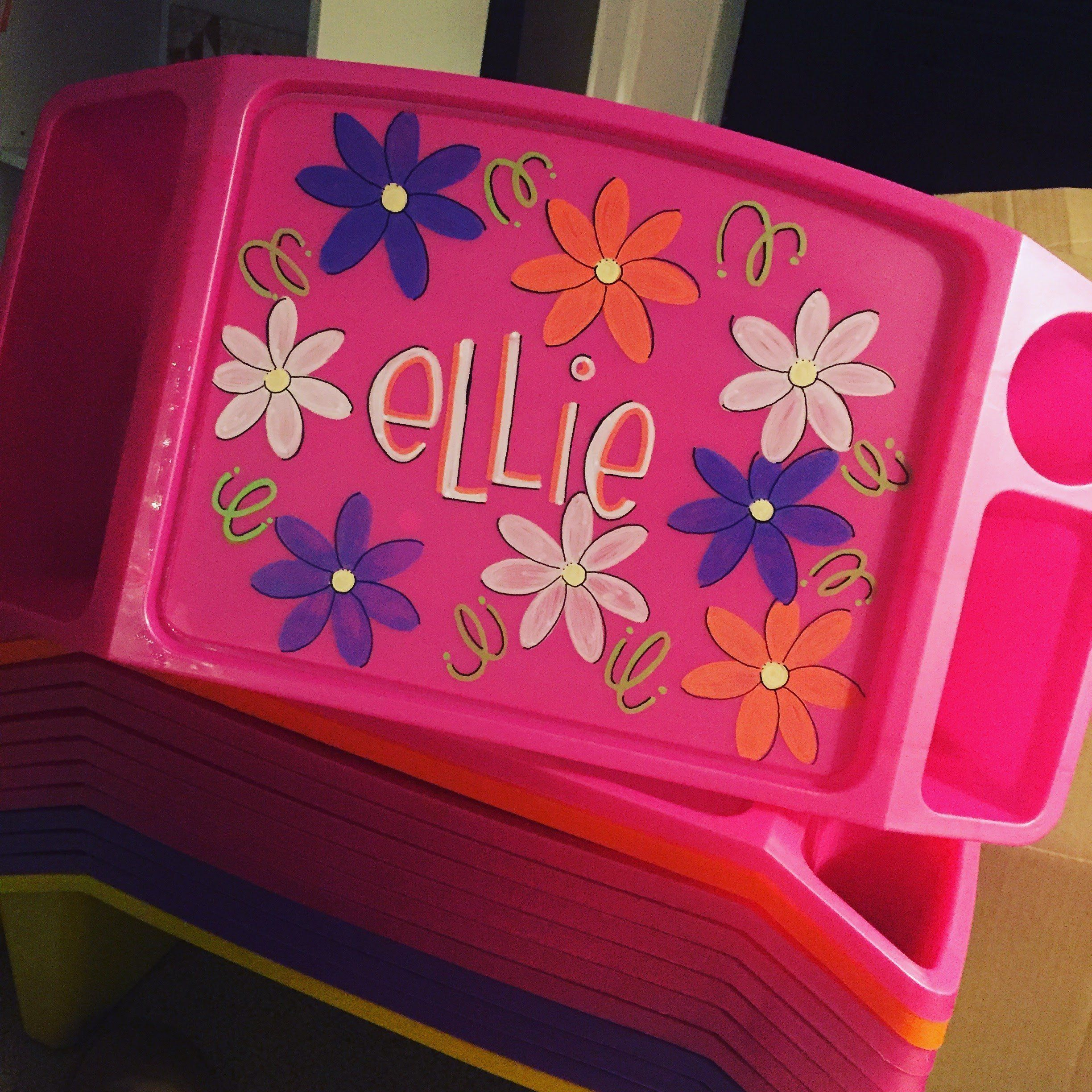 """Hand Painted Lap Tray- Ellie Font. *Hand Painted Personalized Lap Tray* Great for coloring, homework, snacks, and more. Two pockets for storage of books, markers, crayons, pens, etc. 11""""x13"""" surface area. Fits easily over most car seats and strollers. This gift is perfect for on the go or even at home! Lap Tray Colors in Lime, Pink, Purple,Orange, and Yellow . quantities may be limited, so message me with your choice of color prior to ordering to check availability. Designs include but…"""