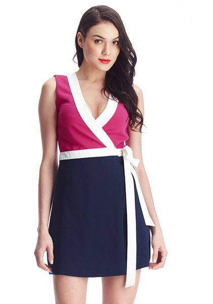 Designer Brands // This pink and navy sleeveless wrap-style dress is a cute number that features a plunging surplice neckline with white trim and wrap style hem.