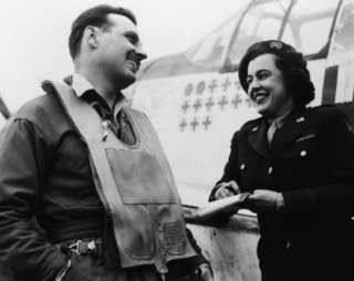 Virginia Irwin, features writer from the St Louis Post-Dispatch, interviews Lt Glennon 'Bubbles' Moran of the 352nd Fighter Group.