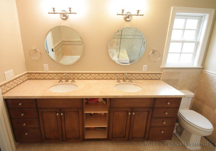 Custom two sink bathroom vanity cabinet with tile trim in restored South  Pasadena bathroom. Custom two sink bathroom vanity cabinet with tile trim in restored