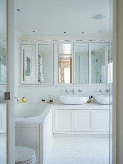 Space saving  bathroom  Transitional Bathroom by Thorp Design  No space has been wasted in the master bathroom, in which Thorp incorporated double basins. A wall of mirrored cupboards keeps clutter at bay and bounces light around, and there's more storage in the vanity unit. The white color scheme creates a quietly luxurious bathing zone.