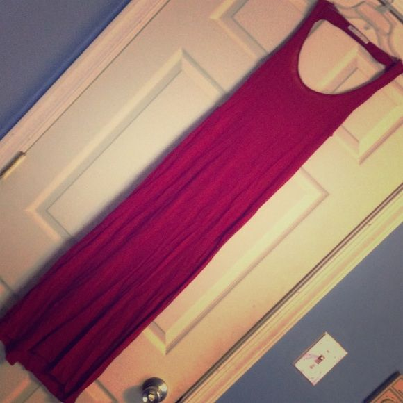Jersey knit halter strap maxi dress Red halter strap jersey knit maxi dress. Has a draped back. Never worn. Has been in my closet just sitting. Unknown Dresses Maxi