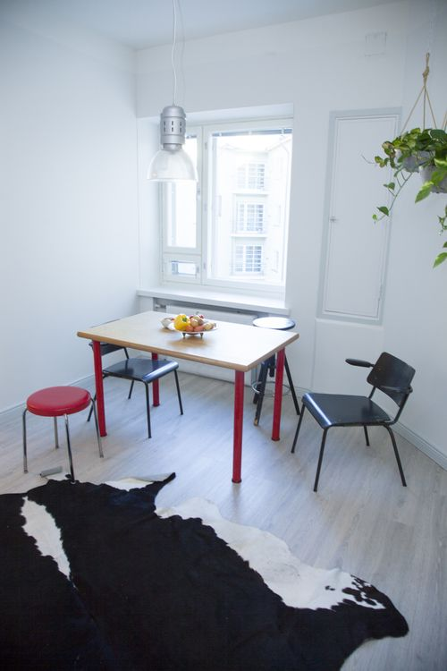 Interior design for renovated kitchen by See and Feel Spatial Design - vintage furnitures - color palette black, red and white - hanging plants