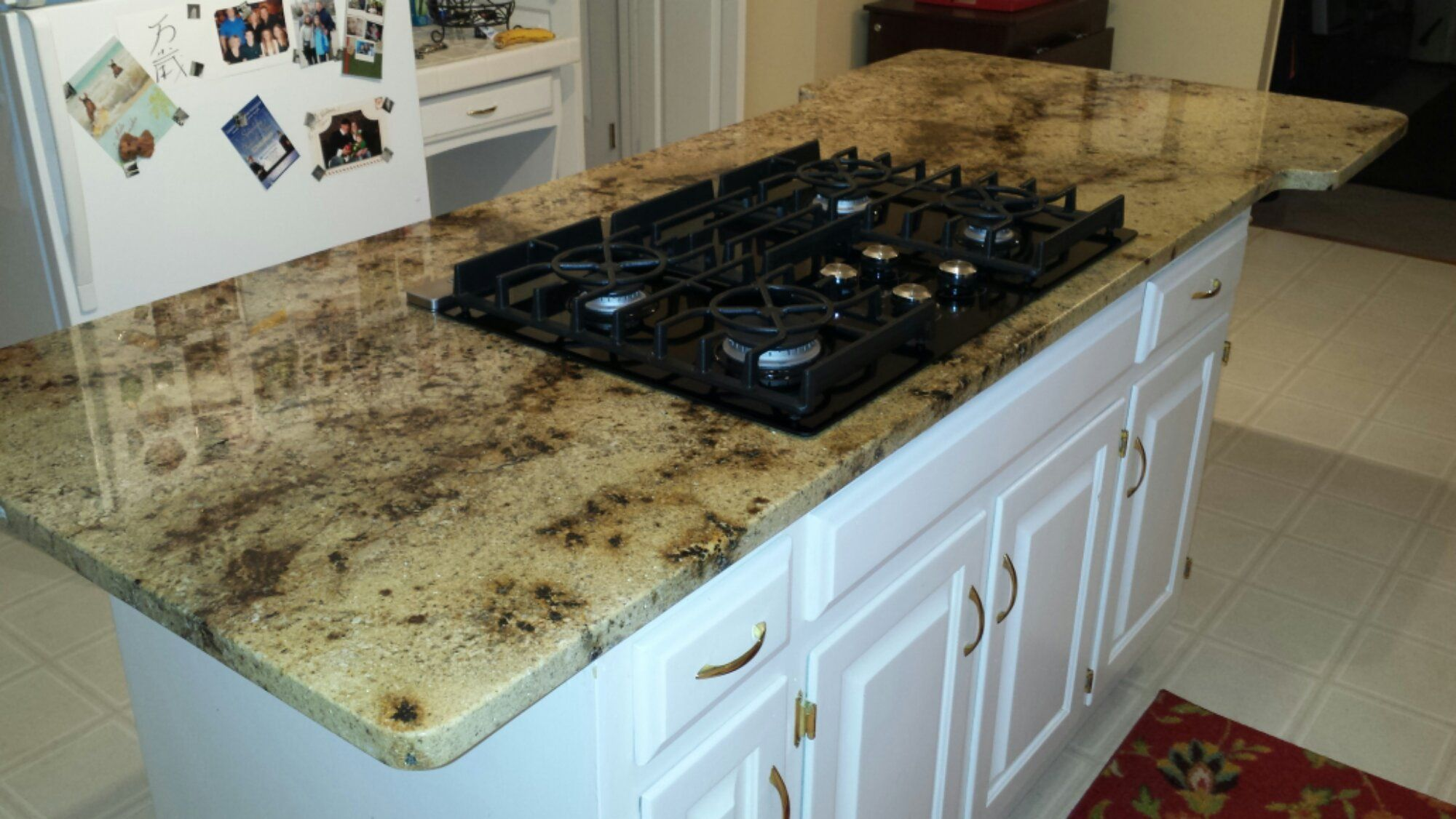 Kitchen island gas range - Granite Countertop On Kitchen Island With Glass Top Gas Cooktop And Telescoping Downdraft
