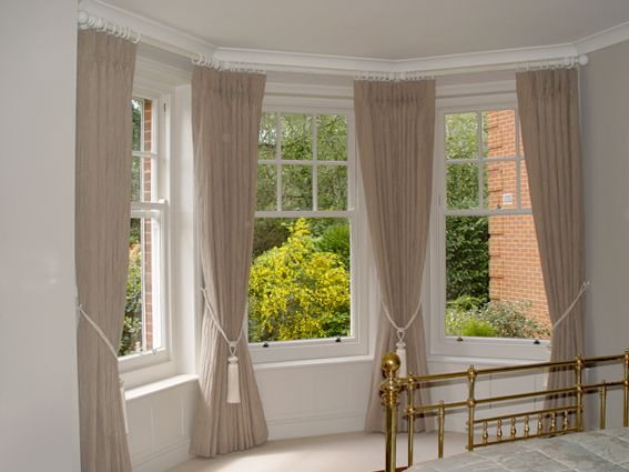 bay window curtains  I like the panels between the curtains to let in more  light