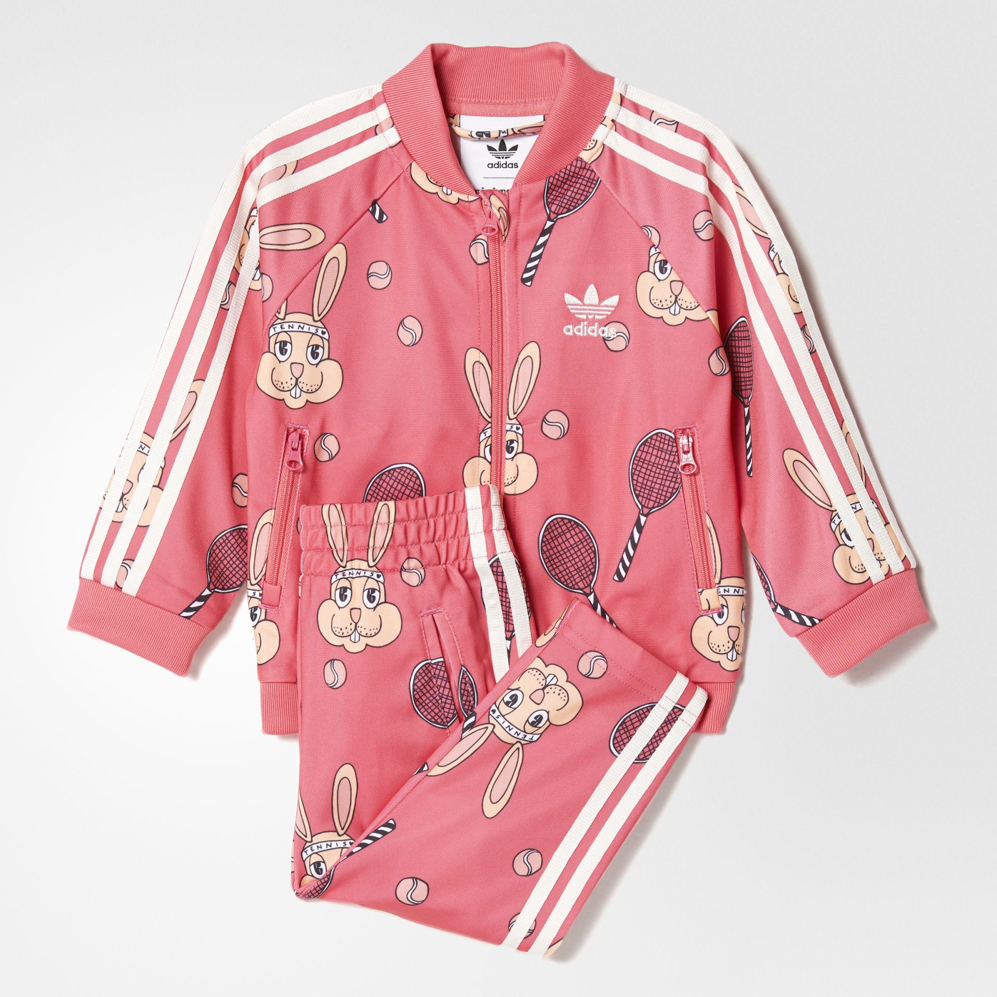 f071b1d7545bf Swedish brand Mini Rodini created the playful bunny-and-tennis-racket print  that covers this fun-to-wear track suit for toddlers.