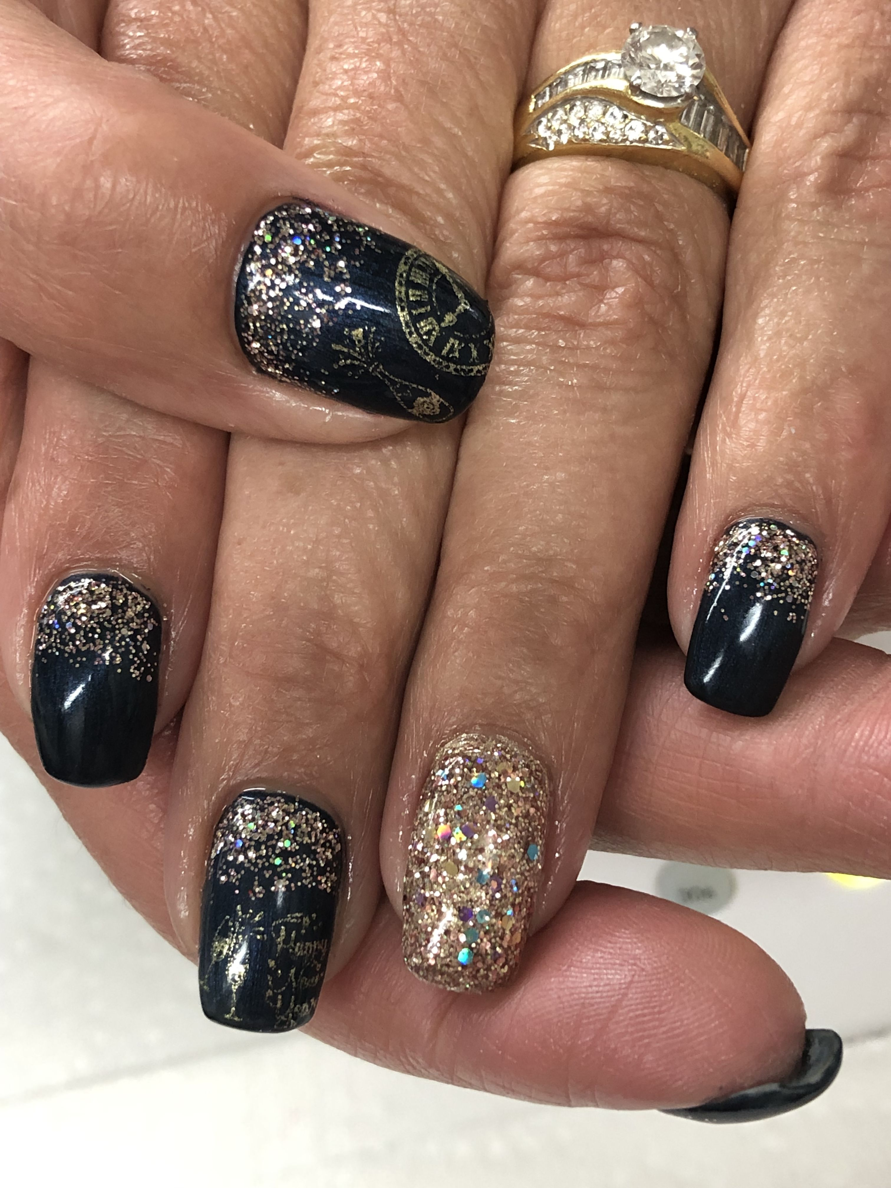 Navy & champagne New Years Gel Nails Light Elegance