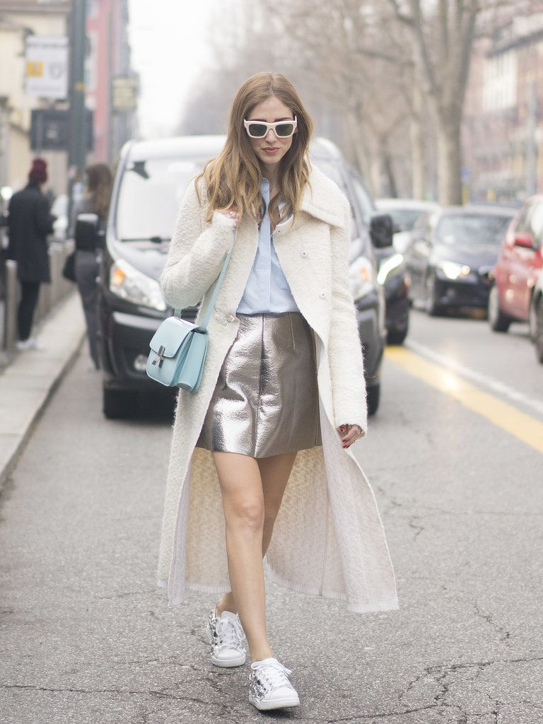 Calvin Klein coat, MSGM silver skirt and light blue shirt and Chiara Ferragni embellished sneakers mar