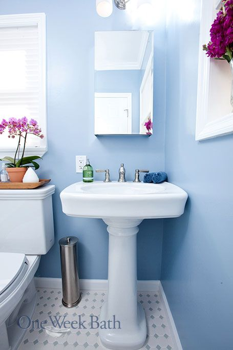 Blue And White Bathroom a blue and white bathroom with a pedestal sinkone week bath