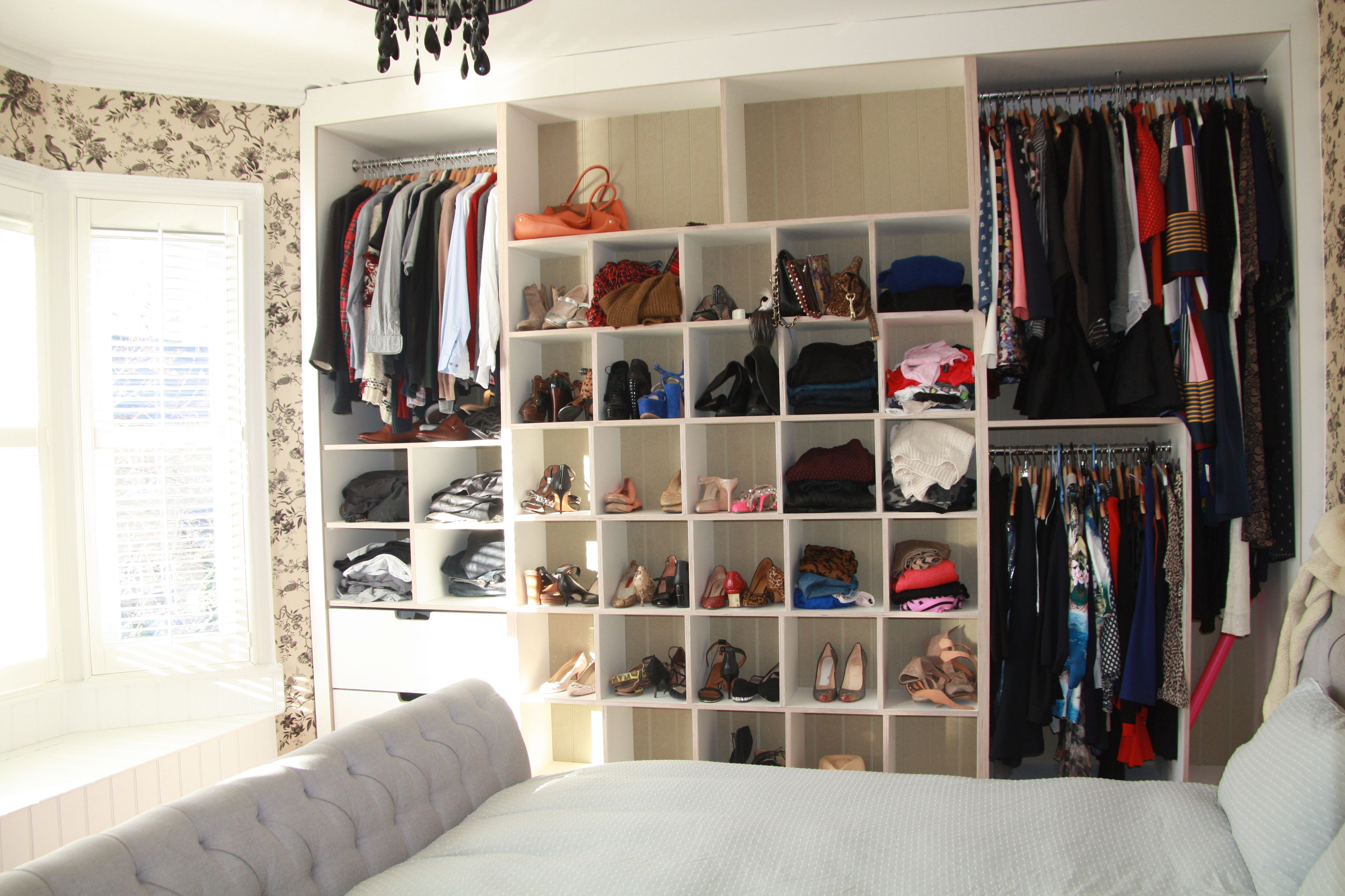 A twist to the normal bedroom wardrobe!!  Cool cupboard designed around the space to create an 'at a glance' open wardrobe with funky cubes for shoes and handbags!